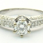 e8439.1 0.58ct tw eng ring