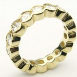 e8901.1 scalloped edge channel set eternity ring