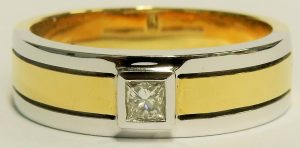 E9624 18 karat yellow and white gold gents diamond ring