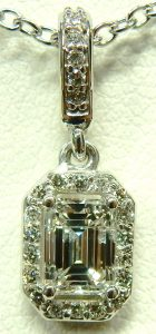 e9604 0.78ct. I1-G emerald cut pendant Stuller setting 85656