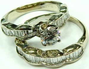 e10255 18kt. baguette and round engagement ring 001