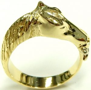 d46dfa8b1 To finish off the graceful ring the bit and bridle have been crafted from  bright white gold, a cool contrast to the warmer hue of 18 karat yellow gold.  As ...