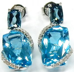 91a5ffb53 A stunning pair of Effy drop earrings that are guaranteed to turn heads at  any holiday party! Playing with the rich tones of topaz the earrings pair  London ...