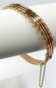 b8adee5f1 The bangle has been equipped with a yellow gold safety chain for added  peace of mind. Estate price $490.00 CAD. Stock #e12248.
